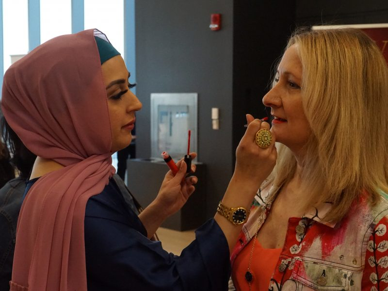 Guests Getting Makeup Touched Up By Pretty Woman Cosmetics