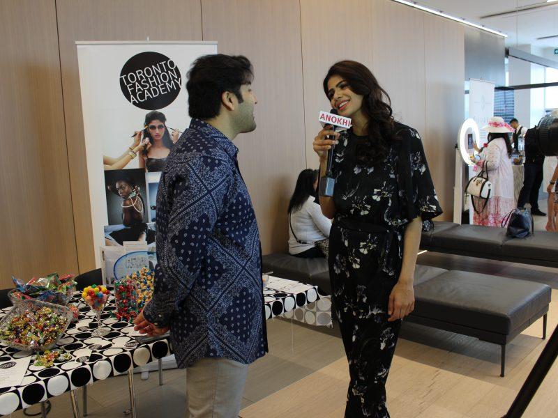(L-R) ANOKHI Pulse TV Host Ruchika Bindra Interviewing Toronto Fashion Academy's CEO Jason Cameron